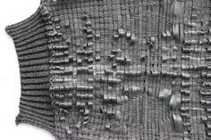 Innovative woven sleeve detail with knitted cuffs & textural weaving; experimental textiles design // Natalie Hitchon