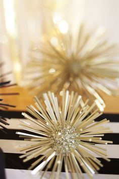 Glittered styrofoam ball and tooth picks, spray painted gold.