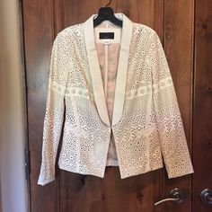 Anthropologie leather laser cut blazer Anthropologie leather laser cut blazer in cream size small--SEE OTHER LISTING FOR MATCHING SHORTS TO FOR ADORABLE SHORT SUIT-- amazing condition-worn once- see tiny faded blue smudge on back from sitting in closet Anthropologie Jackets & Coats Blazers