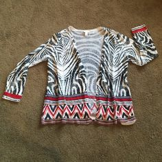 Open Front Zebra Print Cardigan Light weight knit cardigan with red and orange patterned trim on bottom and cuff edges. This was a great topper for traveling because it went with several items, took up little space and didn't wrinkle. Chico's Sweaters Cardigans