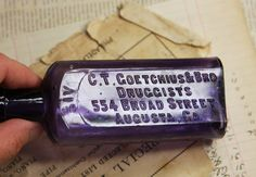 Vintage BOTTLE with Flaw Purple Glass DRUGGIST by VintageSupplyCo