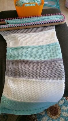 I  made this baby blanket for my new grand baby. I used my cindwood loom , it's my large oval afghan loom with 94 pegs  and 5/8 spacing, I used 83 pegs for this blanket .  It was simple to make just used garter stitch and ewrap. The yarn is by Stitch Studio. The yarn is bulky the colors are white mint and soft grey , it was fun to make. Designed and made by Jeanie Perez