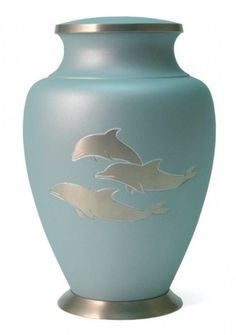 The Casket Store carries a wide variety of urns including Wilbert Urns, Matthews Urns, Elegante Urns, Halo Urns, and Terry Bear Urns. We also carry cremation urn jewelry and biodegradable urns. Memorial Urns, Cremation Urns, Casket, Blue Backgrounds, Biodegradable Products, Dolphins, Brass, Metal, Keepsakes