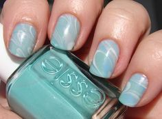 Base: OPI Funny Bunny, marbled with Funny Bunny, Essie Greenport, Essie Shelter Island, and China Glaze Sea Spray
