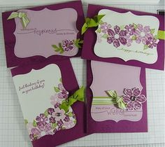 handmade notecard set ... purples ... large tag die cut as main panel ... stamped flowers ... green knotted ribbons ... Stampin' Up!