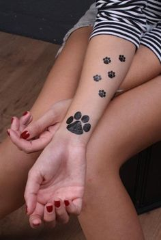 I want a similar tattoo of this with my dogs prints Beautiful Paw Tattoo for Girls