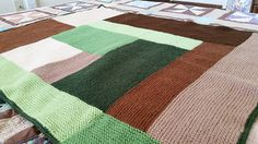 The Moderne Baby Blanket from Mason-Dixon Knitting, done up in woodsy greens and browns.  Farmland from the sky.