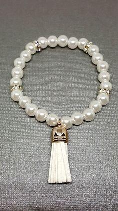 Check out this item in my Etsy shop https://www.etsy.com/ca/listing/522937983/white-bracelet-tassel-bracelet-beaded