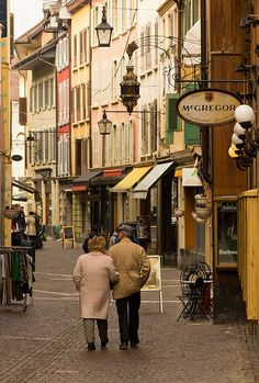 People wandering the streets in Old Town Vevey, Switzerland