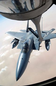 F-15 Eagle: SOUTHWEST ASIA -- An F-15 Eagle from the 33rd Fighter Wing, Eglin Air Force Base, Fla., receives fuel from a tanker assigned to the 401st Air Expeditionary Wing, operating from a forward-deployed location. (U.S. Air Force photo by Master Sgt. Mark Bucher)