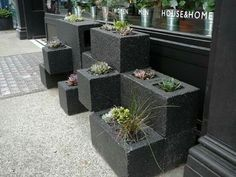 Garden done with bricks as pots... I like it... and you could even paint them each a different colour!