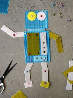 Colorful corrugated cardboard and decorative brads give this #DIY robot puppet his one-of-a-kind character.