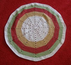 This Radiance Lap Throw is a great project for a beginning crocheter who's tired of making potholders and scarves! All you need to know is how to make the double crochet stitch and the slip stitch, and you can start working in the round (no turning to do either!).