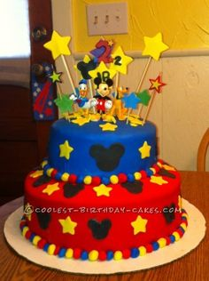 This Mickey Mouse Birthday cakewas a very large cake. The bottom layer is 2 layers of homemade vanilla cake. The top is 2 layers of homemade chocola...
