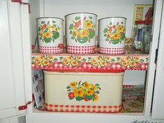 Nasturtium sifters and breadbox in the hoosier cabinet by redkim62, via Flickr