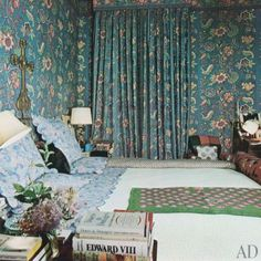 Above is Diana's bedroom.  Does the fabric look familiar?  It is the same as in the living room, but blue!  On the bed is one of Vreeland's silk-printed scarves.  According to the article, that is where Vreeland laid out her outfits for the evening.