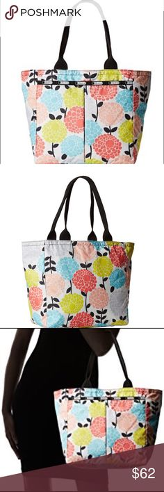 """NWT Lesportsac Everygirl Large Tote Garden Mum 100% Authentic New with Tag! Beautiful Carry All to Tote just about ANYTHING! It's NEW w/tag $82  LESPORTSAC   Everygirl Tote  Pattern Name: Garden Mum  Style# 2221 D563  White background with beautiful flower pattern Black canvas shoulder strap Roomy main compartment with top zipper closure One full-length zippered pocket front exterior Interior one zippered pocket Fully lined inside in white color nylon Measures approximately Top 18"""" Bottom…"""