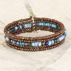 Atmosphere Beads V Wire Cuff    SKU: B2713  Varying color schemes of small glass beads on five shaped wires shimmer together like different horizons. This open band keeps a tight circular shape after slipping over the wrist.