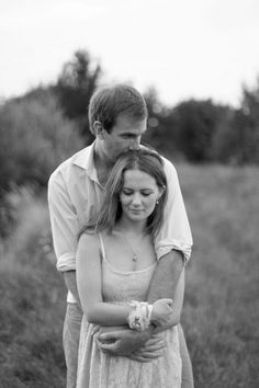 love the kiss on the head engagement shot