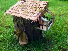 A friend of mine makes these lovely little Fairy homes.  I have seen some of the things he has made and they are all wonderful.    Fairy garden home by DriftwoodinQB on Etsy,