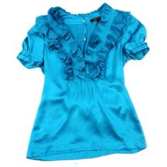 "BCBG MaxAzria 100% Silk Turquoise Ruffle Top $228 ‼️PRICE FIRM‼️    Fantastic fun feminine top.  You are sure to treasure this for years to come.  A gorgeous shade between blue and green.  100% silk.  This top has some stretch to it for a perfect & comfortable fit.  Armpit to armpit up to 34"" Shoulder 18.5"" Waist 29"" Length 25"" BCBGMaxAzria Tops"