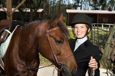 Female equestrian preparing for event