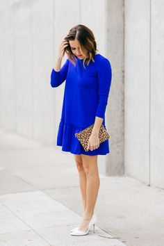 Anna of FleaurDille is looking brilliant in our bright blue long-sleeve drop waist dress. She dresses her look up by adding a pair of white pumps and a leopard printed clutch   Banana Republic