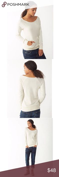 Maniac Eco Fleece Sweatshirt A raw-edge, off-the-shoulder neckline and kangaroo front pocket give this cozy sweatshirt its vintage-inspired appeal. Made of natural fleece alternative, it's the perfect way to stay warm in style.   Fabrication: 50% polyester/46% cotton/4% rayon Color: Eco Wheat Machine wash and tumble dry Imported Alternative Apparel Tops Sweatshirts & Hoodies