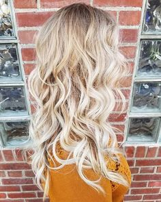 Gorgeous baby blonde balayage waves by Aveda Artist Amy Wry.