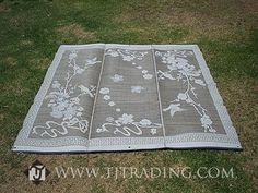 We needed to temporarily carpet an arena sand floor for the reception & my aunt, being the horse enthusiast she is, suggested we look up these mats they use at horse shows. We got 7 9x12 mats in this pattern for around $300. They're meant to be used outdoors so we split them up after the wedding & reused them for our decks, porches, etc.