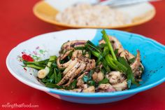 Try this simple (and delicious) Thai recipe for squid stir fried with shrimp paste, green onions, and black pepper. It's easy and tastes incredible!