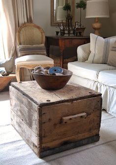 A trunk to a coffee table!  And just take in the details of this old trunk.... in case you overlook any...I'll point out the wooden handles, the metal along the base, the rusty hardware....   yes!