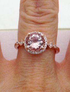 https://www.etsy.com/listing/267940738/145-carat-rose-gold-morganite-ring-with  Big round morganite rose gold ring. 1.45 carat 7.5mm morganite with accent diamonds on the halo and band. 14K Solid Gold