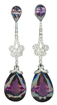 Amethyst and Diamond Pendant Earrings, 2 pear-shaped amethysts, 2 amethysts ca. 64 carats, 113 diamonds ca. 1,76 carats, mounted in platinum. Argentina, Circa 1920-1930's.