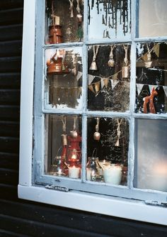 Take a tattered window, replace panes with photos and decorate.