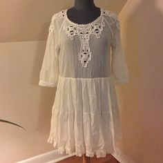 White Free People Dress (Size M) Super pretty, white Free People dress in perfect condition. Outer dress is 100% cotton and the skirt is 100% rayon. Size M. Free People Dresses Mini
