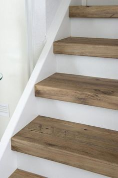 Removing carpet from stairs and replacing it with wood stair treads is totally doable. This DIY staircase makeover was accomplished in a weekend and looks like a professional job! Proof that a staircase remodel can be a DIY job. Wood Stair Treads, Wood Stairs, Basement Stairs, Replacing Stair Treads, Painted Stairs, Step Treads, Basement Ceilings, Basement Flooring, Kids Basement