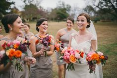 Rustic Chic Georgia Wedding. purples, corals, oranges, everything i love assortment of flowers.
