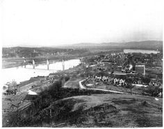 The view from Boynton park in 1906, You are looking northeast at Chattanooga, Tennessee from Boynton Park on Cameron Hill. Shown are the Tennessee River, the Walnut Street Bridge, Loomis and Hart, White Oak Distillery, and Chattanooga Brewery