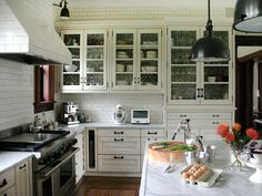 I'm obsessed w/ white kitchens; not a fan of the industrial lights though