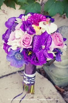 Varying shades of purple flowers make this elegant bouquet stand out.
