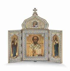 A LARGE & IMPORTANT SILVER-GILT CLOISONNÉ, CHAMPLEVÉ & EN PLEIN ENAMEL TRIPTYCH - MARKED P. OVCHINNIKOV WITH THE IMPERIAL WARRANT, MOSCOW, 1899-1908 - Of ogee arch form, surmounted by a cross, the hinged covers opening to reveal an icon of St Nicholas, flanked by the Mother of God & Christ Pantocrator, all within lavishly decorated mounts with shaded cloisonné enamel... 17¾ in. (45 cm.) high