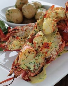 Homard Thermidor ~ the lobster is buttered, sauced and placed back into it's shell (langoustes or homard is lobster)