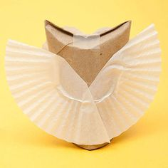 Cut eyes and a beak from card stock. (For the snowy owl, cut circles from a cupcake liner to back the eyes.) Add pupils and dots with marker. Glue the eyes and beak to the tube. For ruffled wings, cut sections from a liner and glue them to the back of the tube (B). For smooth wings, attach a curved half-circle of card stock instead.                 Originally published in the October 2012 issue of FamilyFun magazine.