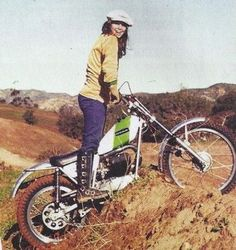 Vintage motocross/trials girl, Debbie Evans, looking stoked as all hell on her Ossa motorbike, wearing what look like Hondaline boots (but c...