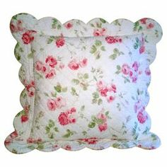"Bring a touch of country-chic style to your guest bedroom or master suite with this charming scalloped pillow, showcasing a floral motif and quilted details.   Product: PillowConstruction Material: 100% Cotton coverColor: White and pinkFeatures: Quilted detailsInsert includedDimensions: 16"" x 16""Cleaning and Care: Hand wash cold and lay flat to dry"