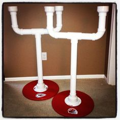 "Cornhole Beer Holders- Can be made for $25-$35 each.  Everything you need is at your local Home Depot! Field Goal is made with PVC pipe and the base is wood (already cut into a circle for $6) Connected with a flange. (Plastic is cheaper than those made with metal). The body of the field goal is 2"" tall. We added our own sticker decals.....Go Chiefs!"
