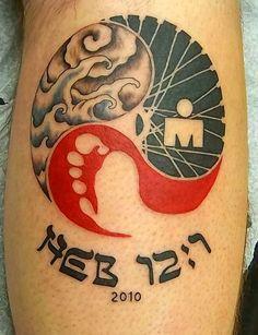 ironman triathlon tattoo at holy roller tattoo