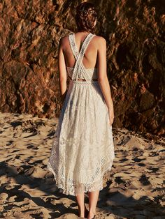 Gemma's Romance Dress | Ethereal lace maxi dress with a strappy open back and sweeping silhouette. Modern bustier with metallic and ivory chevron embroidery; structured with side boning. Skirt features a hidden back-zip closure.   *By Free People   *Leave them breathless. This exclusive capsule of dreamy and ethereal wedding dresses was created for the romantic bride by a Free People designer.    *White   *Two-Piece Wedding Dress   *Open Back   *Zipper Closure   *Lined