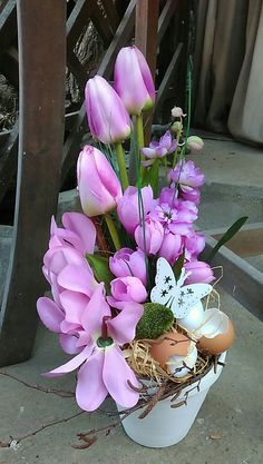 Easter And Spring Decorations. White Flower Pot With Pink Flowers